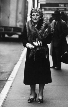 Woman wearing a mink stole and bow shoes, a photo by Diane Arbus, New York City, 1956 Diane Arbus, Claudia Roth, Circus Performers, Vivian Maier, Cindy Sherman, Famous Photographers, Bow Shoes, Portraits, The New Yorker