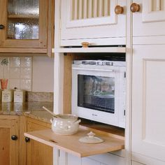 "Oak country kitchen | Kitchen design | Decorating ideas | Image | -- love this ""garage door"" idea to stash an appliance!"