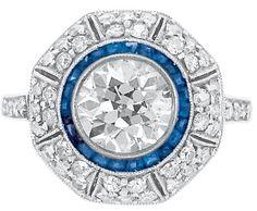 Platinum, Gold, Diamond and Sapphire Ring.    One old European-cut diamond ap. 1.15 cts., c. 1905, ap. 2.6 dwt. Size 3 1/2. Doyle New York.