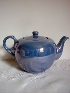 Vintage Teapot Blue Lustreware by PoetryofObjects on Etsy, $25.00/ I have this whole set.sec