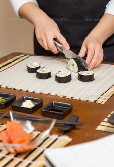 Closeup of woman chef cutting japanese sushi roll ...  asia, asian, avocado, bamboo, chef, crab, cucumber, cuisine, cut, cutting, diet, dinner, female, fish, food, fresh, ginger, girl, gourmet, hands, healthy, japan, japanese, knife, lunch, make, maki, mat, nori, oriental, portrait, preparation, prepare, raw, restaurant, rice, roll, rolled, salmon, sashimi, seafood, seaweed, sheet, shrimp, soy, soya, sushi, traditional, wasabi, woman