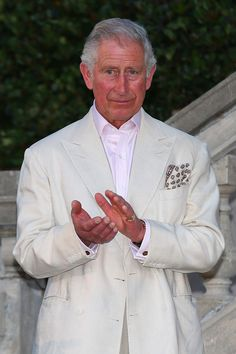 Prince Charles looks on while attending a reception for his birthday.