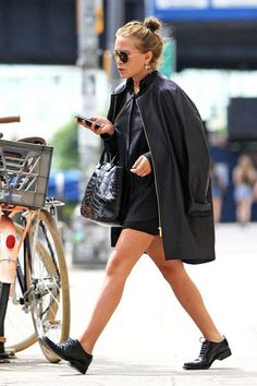 Mary-Kate Olsen // top-knot, aviator sunglasses, oversized coat, patent croc tote bag, shorts & oxfords
