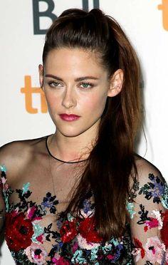 Kristen Stewart rocks a high ponytail with sleek sides.