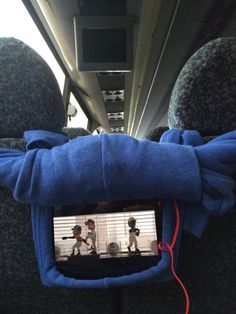 Makeshift Ipad holder. Rolled up sweatshirt-easy to watch movies on bus or in car! My teammates are wicked smart. #DIY