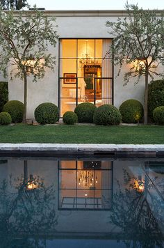 garden pool exterior, attributed to Scott Shrader. I love the asymmetrical placement of the boxwoods, and the way in which the trees and steel window reflect in the pool.Top pinned images of January 2014 Exterior Design, Interior And Exterior, Outdoor Spaces, Outdoor Living, Houses Architecture, Garden Pool, Garden Landscaping, Future House, Outdoor Gardens