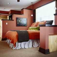 A stepped partial wall used as transitional divider between zones...functional and adds a great deal of visual interest. Used here in a bedroom.