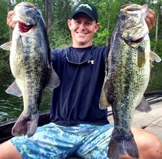 flw tour pro andrew upshaw holds two giant largemouth bass Fishing Rods And Reels, Rod And Reel, Gone Fishing, Bass Fishing, Pictures Of Largemouth Bass, Big Spoon, Shallow, Spoons, Water