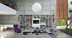 """""""All houses done by our office are designed around the library,"""" says Omer Dagan, an architect in Pitsou Kedem's eponymous Tel Aviv, Israel, firm. It's a boldly bibliophilic conceit, and an idea that makes an especially strong impact in Kedem's 2011 Haifa House. Photo by Amit Geron."""