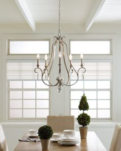 The French Provincial-influenced DeWitt lighting collection by Feiss has a traditional and elegantly simple silhouette. It's updated using the dramatic contrast of rustic, gilded finishes, either Weathered Iron or Sunrise Silver (shown). Dining Room Light Fixtures, Dining Room Walls, Dining Room Lighting, Kitchen Lighting, Dining Room Chandeliers, Eclectic Chandeliers, Bathroom Lighting, Cottage Lighting, Home Decor