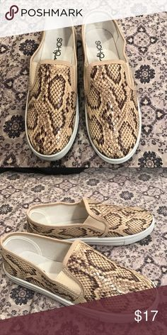 Faux snake skin slide on shoes Faux snakeskin slide on shoes. New without tags, never worn. Would be cute paired with blue jean shorts and a white or tan tee for summer! Size: 8.5 Shop Hopes Shoes Sneakers