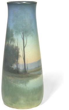 A ROOKWOOD vellum glazed earthenware Landscape vase  decorator Carl Schmidt, 1917 w/ impressed Rookwood marks, artist's conjoined initials within a circle and 950B V. (hva)