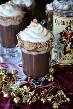 Hot Coco Bay: 1oz Baileys Irish Cream, 1oz Captian Morgans Spiced Rum, Prepared Hot Chocolate. Add the Baileys & Cpt Morgans to a coffee mug and fill with hot chocolate. Top with whipped cream and garnish with honey and coconut!