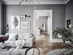 I like the combination of the cool grey walls with the warm wooden flooring in this apartment. The white linen bedding in the bedroom makes this room look very fresh and the natural Thonet dining chairs in the living room … Continue reading → Living Room Grey, Living Room Decor, Casa Milano, Gravity Home, Scandinavian Home, Scandinavian Apartment, Living Room Inspiration, Grey Walls, Interiores Design