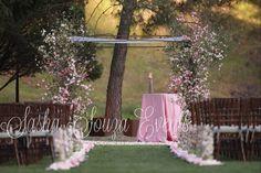 Elegant Springtime Wedding Chuppah with cherry blossom and pink dogwood. Image by Sherman Chu. Design by Sasha Souza Events.