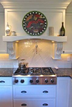 kitchen hood and cooktop and pot filler faucet