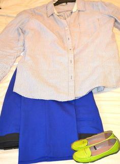 A simple grey and white striped button down shirt with royal blue slacks and neon loafers