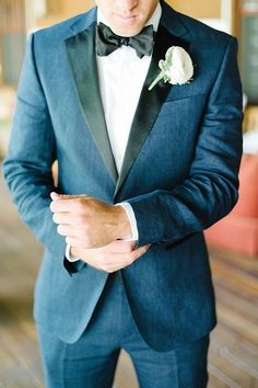 Navy blue and black with bow tie groom attire or summer wedding