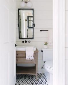 Kate Marker Interiors: Cement Tile Shop Atlas II encaustic tile floor & RH Industrial Rivet Pivot Mirror