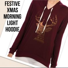 NEW Foil Reindeer Lightweight Hoodie- Burgundy How adorable is this for the holidays?!? This is a very lightweight soft hoodie, good for layering a long sleeve shirt underneath. 95% Rayon, 5% Spandex, 30' long. Pair with leggings or skinny jeans. So comfortable! Price is firm unless you bundle items together. Have other sizes, check listings. Tops Sweatshirts & Hoodies
