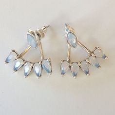 Opal Jacket Earrings NWT. You could wear these just as studs or as jacket earrings. Silver plated brass and Opal crystals. So pretty! Only 2 pair available. I also have one Rose pair available. Price is firm. Sunahara Jewelry Jewelry Earrings