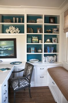 Love the color on the back of the built ins. Interior by DL Rhein. I like that colour for my bathroom accent wall
