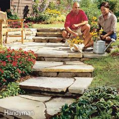 plan and build dry-laid natural stone steps and path, using flat flagstones for the treads and thicker blocks of matching stone for the risers.