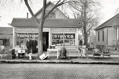 """December 1936. """"Secondhand store in Council Bluffs, Iowa."""" 35mm nitrate negative by Russell Lee for the Farm Security Administration."""