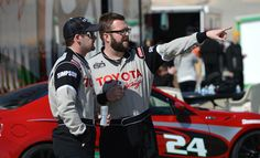 """Toyota Pro/ Celebrity Race participants Olympic gold medalist simmer Tyler Clary,left, and co-host of """"Top Gear """" Rutledge Wood, talk stratagy during a practice session at Willow Springs Raceway."""