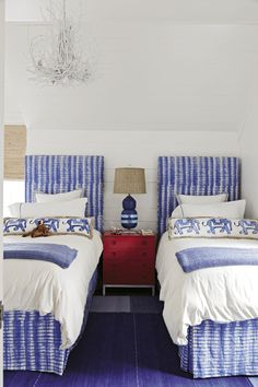 bedroom with periwinkle blue accents, sherwin williams dahlia, lavender blue interior