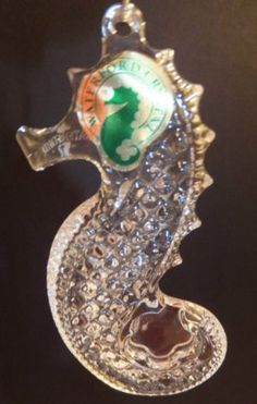 Waterford Crystal Seahorse Ornament have him under another glass cloche in house.