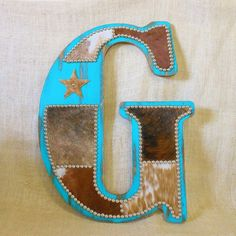 Turquoise Cowhide Wall Letter by Lizzy & Me. Handcrafted in the U. Turquoise Cowhide Wall Letter by Lizzy & Me. Western Crafts, Rustic Crafts, Country Decor, Rustic Decor, Rustic Wood, Home Projects, Home Crafts, Cowboy Nursery, Western Christmas