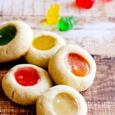 Gummy Bear Thumbprint Cookies. I've made these but never with gummy bears! Super excited to try it!