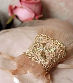 old lace cuff, adorned with gold cord design- hand embroidery.