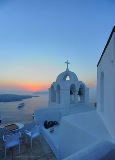 Sunset from Aigialos Hotel  With a breathtaking view of the world-famous Aegean caldera, the volcano and the deep blue waters of the Mediterranean Sea, Aigialos Hotel, strategically located at the edge of Fira city-Santorini.