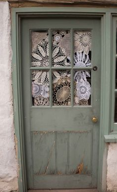 Wild Yarns and Stuff- maybe do this with an old window instead. I like the random doilies.