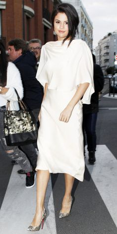 Selena Gomez in a caped ivory silk Sybilla backless dress with Louboutin pumps.