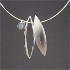 Google Image Result for http://www.crafthouston.org/wordpress/wp-content/uploads/2012/02/Gerstacker-Heidi-jewelry-metal-marquise-pendant-268x268.jpg