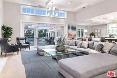 1 bdrm suite + custom media rm, powder & mud rm on 1st flr. 3 bdrm suites + huge master w/ frplc, built-ins, terrace, dual closets & massive bath up. The grounds are an entertainer's paradise w/ sep rec room w/ liv rm, wet bar, bed/ba. An outdoor liv rm w/ frplc + outdoor din rm w/ BBQ & massive swimmers pool surrounded by grassy yard.