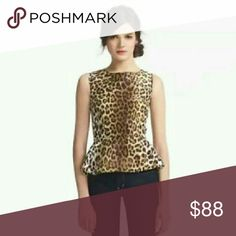 "Kate Spade Leopard Peplum Top ""Randi"" leopard cheetah print top You can never have too much animal print! Fun and flirty peplum top in 100% silk. Fully lined  This peplum top is your answer to looking sharp for work, after hours with jeans, or anytime you want to be looking your best. Pair with a sassy pencil skirt for sheer sophistication. Full length gold exposed decorative zip detail.  Says 10, but definitely fits like a 6-8. Offers welcome. 20% off bundles. kate spade Tops"