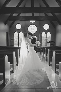 Large classic chapel with wooden pews and lots of windows at Vesica Piscis Chapel in Catoosa, OK. Wedding photography by Redeemed Productions.