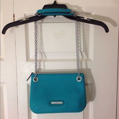 "Teal green Liz Claiborne purse w/adjustable strap Teal green in color, squarish in shape.  Textured synthetic leather.  Long adjustable strap.  All metal components are silver-tone.  Brand new without tags.  Measurements are as follows:  9 ½"" across, approx. 6 7/8"" tall, approx. 1 ¼"" deep (across the bottom) but considerably expandable, 12"" strap drop (when doubled for shoulder-carry length - see 1st pic), 23"" strap drop (when extended to cross-body length - see 2nd pic). Liz Claiborne Bags…"
