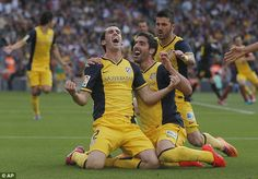 Diego Godin celebrates scoring the goal that won Atletico the title at the Nou Camp in 2014