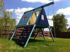 cool triangle shaped playhouse with climbing wall