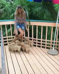 Girl followed by a bunch of puppies http://ift.tt/2fytYHu