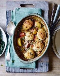 Pork is slow-cooked until succulent with cider, apples and root vegetables to make a rich, hearty stew, then topped with light dumplings for a truly comforting dinner.