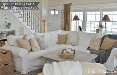 Lots of texture and the use of neutrals blend well with this beautiful white living room.
