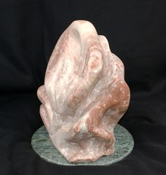 Rose a stone sculpture by the artist Karin Teresa Fain copyright 2005. ALL RIGHTS RESERVED