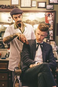When your barber dusts you off like an ancient artefact. Lausy Lau finishing the royal Schorem treatment on his old buddy Barber Poster, Barber Logo, Gentleman's Cut, Leopard Makeup, Beard Styles, Hair Styles, Barber Apron, Barber Shop Decor, Stylist Tattoos