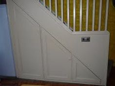Fitting a Door Beneath the Stairs With the basic panel below the stairs completed you could just decorate it to match the room. However, adding a door, fielded panelling and other details will create Staircase Storage, Stair Storage, Home Design, Bin Shed, Concertina Doors, Tiny House Stairs, Under Stairs Cupboard, Built In Cupboards, Shaker Doors